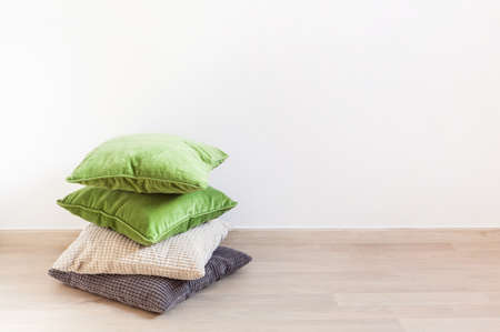 gray and green cushions, cozy home Stok Fotoğraf - 98286471