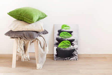 gray and green cushions, throw. cozy home