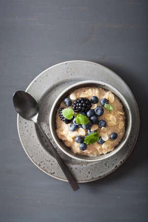 Healthy breakfast steel cut oatmeal porridge with blueberry.