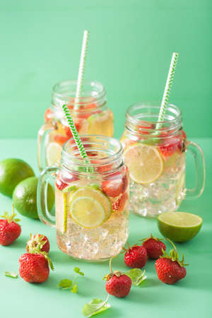 refreshing summer lemonade with strawberry and lime in mason jar