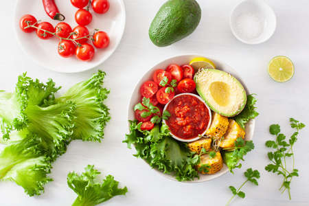 vegan buddha bowl. healthy lunch bowl with avocado, tomato, sweet corn and salsa 스톡 콘텐츠