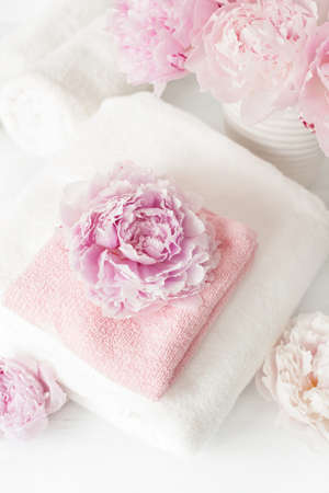 bath and spa with peony flowers towels Stock Photo