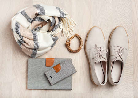 women's flat lay clothes shoes, scarf, bracelet, tablet, smartlphone. Fashion blog, clothing, shopping