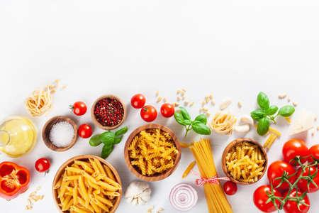 ingredients for italian cousine flat lay, pasta spaghetti penne fusilli tomato oil vegetables Standard-Bild - 108933196