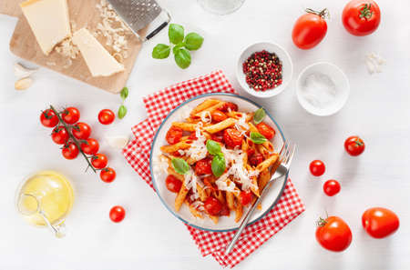 Italian penne pasta with tomatoes parmesan basil