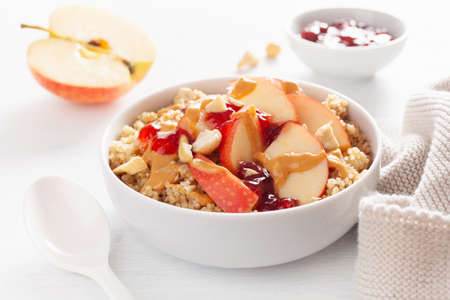 Apple peanut butter quinoa bowl with jam and cashew for healthy breakfast