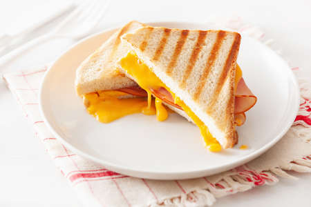 grilled ham and cheese sandwich Imagens