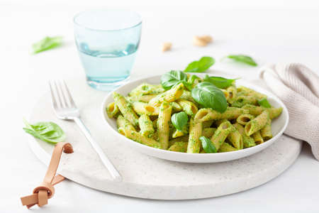 penne pasta with spinach basil pesto sauce 写真素材