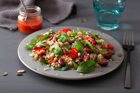 healthy bean and quinoa salad with spinach, chili