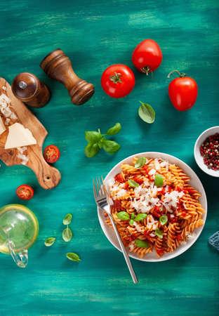 Healthy fusilli pasta with tomato sauce parmesan basil