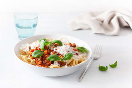 Spaghetti bolognese with basil and parmesan, italian pasta Фото со стока - 116185145