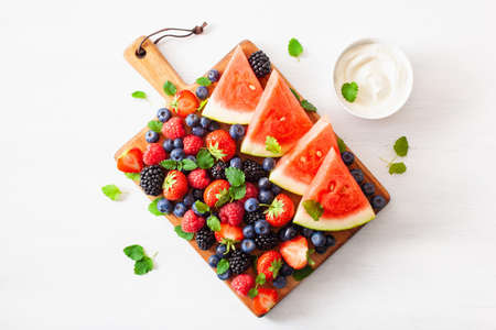 Fruit and berry platter over white. Blueberry, strawberry, raspberry, blackberry and watermelon Archivio Fotografico