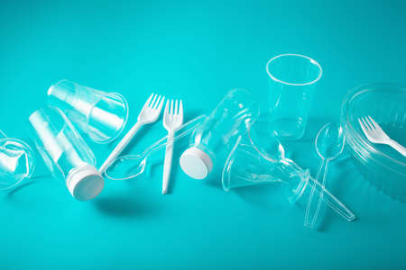 Single use plastic bottles, cups, forks, spoons. concept of recycling plastic, plastic waste Banco de Imagens