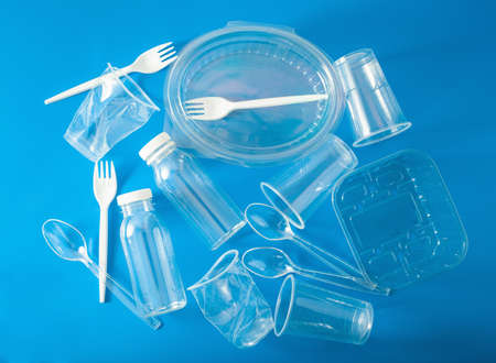 Single use plastic bottles, cups, forks, spoons. concept of recycling plastic, plastic waste Archivio Fotografico