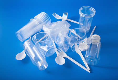 single use plastic cups, forks, spoons, bottles. concept of recycling plastic, plastic waste