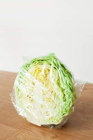 cabbage vegetable in plastic bag. single use plastic packaging issue.