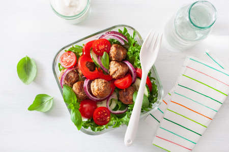 keto paleo lunch box with meatballs, lettuce, tomato, cucumber, bell pepper