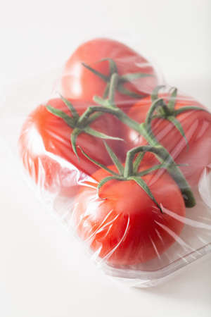 Single use plastic packaging. Tomatoes in plastic bag