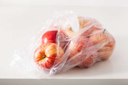 single use plastic packaging issue. apples in plastic bag