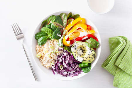 veggie couscous lunch bowl with avocado, bell peppers, spinach and red cabbage