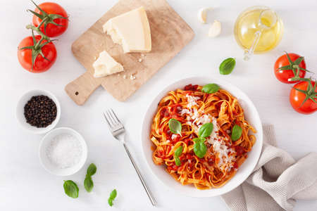 tagliatelle pasta with tomato sauce parmesan basil Stockfoto