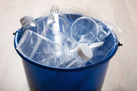 clean recyclable plastic bottles, containers, cups in garbage bin. waste management plastic reuse Stockfoto