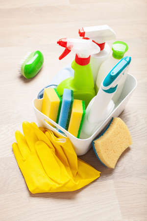 cleaning products household chemicals spray brush sponge glove Stock Photo