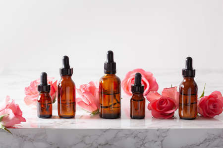 essential oils in bottles rose flowers. alternative medicine aromatherapy Stock Photo
