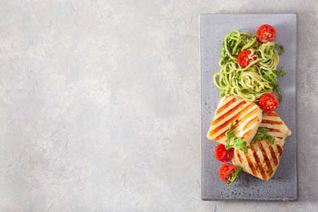 ketogenic paleo diet lunch. halloumi cheese, spiralized zucchini with arugula pesto and tomatoes