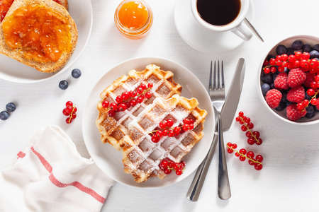breakfast with waffle, toast, berry, jam and coffee. Top view Stockfoto