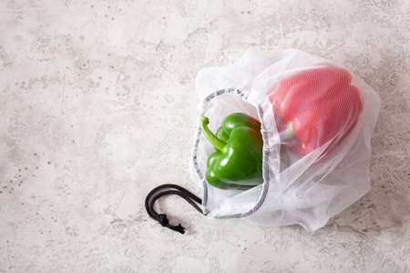 bell peppers in reusable mesh nylon bag, plastic free zero waste concept