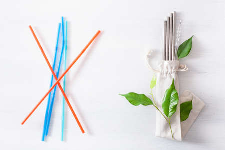 single use plastic and reusable metal eco-friendly drinking straw. zero waste concept