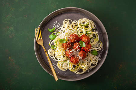 keto paleo diet zoodles spiralized zucchini noodles with meatballs and parmesan Stock fotó