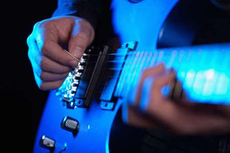 musician rock guitarist playing a blue guitar Stock Photo