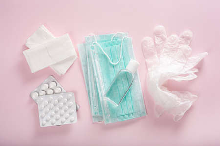 protective medical mask, sanitizer gel and gloves. protective measures against virus, bacteria Stock Photo