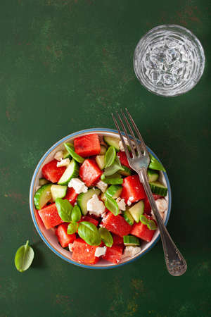 watermelon salad with feta cheese, cucumber and basil. healthy summer dessert Foto de archivo