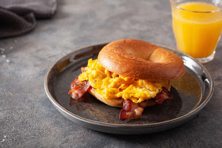 breakfast egg and bacon sandwich on bagel with cheese Reklamní fotografie - 150122392