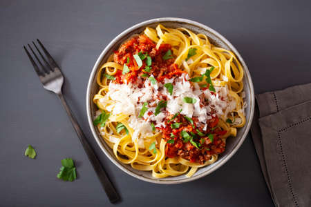 tagliatelle bolognese with herbs and parmesan, italian pasta