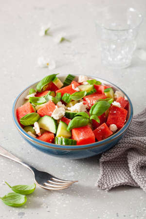 watermelon salad with feta cheese, cucumber and basil. healthy summer dessert Standard-Bild