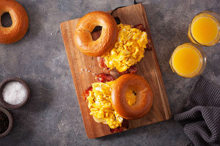 breakfast egg and bacon sandwich on bagel with cheese