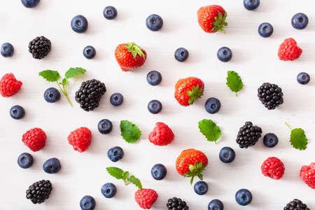 assorted berries over white background. blueberry, strawberry, raspberry, blackberry Standard-Bild