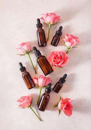 essential oils in bottles rose flowers. alternative medicine aromatherapy Standard-Bild