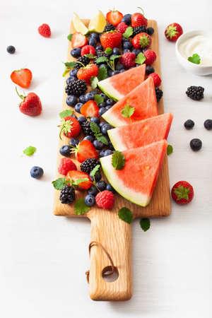 fruit and berry platter over white. blueberry, strawberry, raspberry, blackberry, watermelon