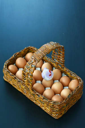 wooden basket with eggs and sowing hens laying eggs Stock fotó