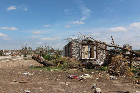 The only part of this tornado damaged home is the portion that was made with native stone. Stock Photo - 12410392
