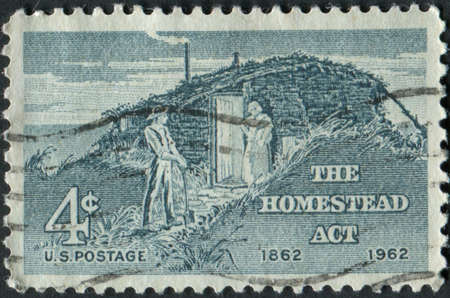 homestead: United States of America-Circa 1962  A stamp commemorating the centennial of the Homestead Act   Editorial