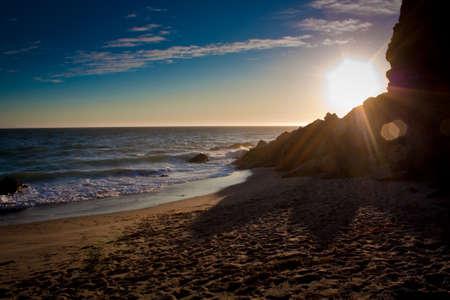malibu: Beachside Cliff Sunset Stock Photo