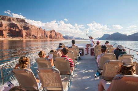 lake powell: Tourists exploring Lake Powell on tour boat.