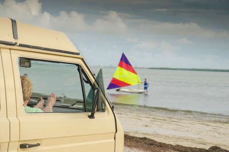 dub: Vanagon and sunfish sailboat at Dunedin Causeway.