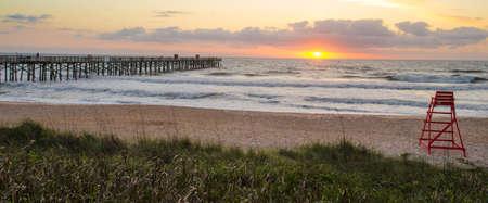 sea oats: Sunrise over Flagler pier, at Flagler beach Florida. Stock Photo